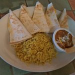Chicken quesadilla with rice and beans.