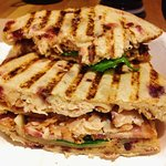 Sliced turkey and bacon in cranberry bread sandwich