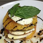 Heirloom tomatoes with imported mozzarella from Italy with olive oil and a balsamic vinegar