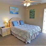 The Seashore room has a queen size bed and a balcony.