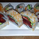 two different sushis - a California roll and the four big pieces - a Chicago super crazy roll