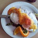 Eggs Benedict over potato pancakes and asparagus
