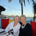 Beautiful View of My Wife and Her Sister from our table overlooking the bay