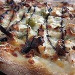 Pizzas artisanales, coulis fait maison. Le bonheur des papilles.