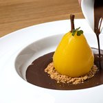 Poached pear, vanilla ice cream, cinnamon biscuit, chocolate, hazelnuts
