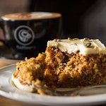 Our scrumptious carrot cake with a perfectly crafted cappuccino