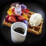 Waffle with strawberries, golden syrup and vanilla ice cream