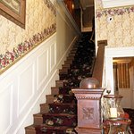 Staircase leading up to upper level rooms including haunted room #19