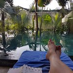 Relax and a read by the pool. (Apologies for the standard toenail shot,)