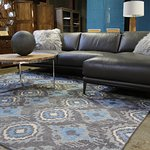 We also showcase a line of 100% Italian leather - including this sleek but comfortable sectional