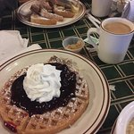 Superb French toast and blackberry waffle! Cozy fireplace on a snowy morning!
