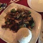 Papaya salad, Thai iced tea, tom yum soup with shrimp, sautéed beef with rice, pad see ew noodle