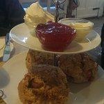 Delicious warm plum scones with homemade jam