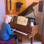 Sue couldn't resist the Steinway baby grand & played Hallelujah