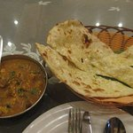 Garlic naan bread and a spicy coconut curry
