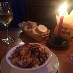Galician octopus dish with the bread and white wine