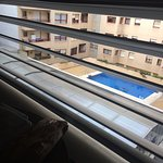 View from hotel room overlooking people's private flats and private pool.