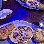 Crab au gratin, stuffed potato, and garlic bread.