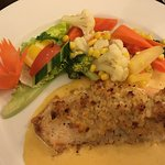 Salmon with prawn and crab crust in bed of lobster sauce. Delicious, perfectly cooked and hot. O