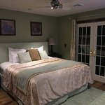 Super comfortable King size bed with luxurious bedding with french doors to the private patio