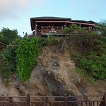 view of restaurant from hotel seating area below the cliff