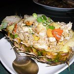 fried rice with vegetables in a pineapple