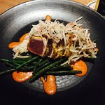 Curry & Cumin crusted Ahi served on a bed of basmati rice with Chinese long beans and a green pa