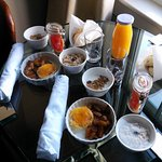 The breakfast unpacked on a table near the window.