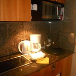 sink, ceramic top stove (2 burners), microwave, dw, mini fridge, cupboards with dishes/utensils