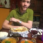 My partner smiling. This was our main course with rice, naan bread and a glass of wine each.