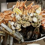Seafood platter (warm) with shrimps, prawns, mussels, vongole clams, razor clams and langoustine