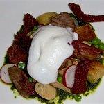 Slow-roasted lamb with gnocchi, kale pesto & parmesan foam