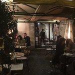 Sidewalk tables in front of Bottega del Caffe