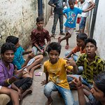 Slums boys want pictures in friendly way