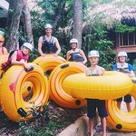 Family river tubing down the Macal River