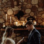 Exchanging vows in front of the fireplace.