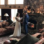 Exchanging vows in front of the fireplace. The natural light was amazing!