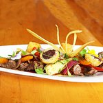 Lomo Saltado with yucca in textures, Eye fillet, poached vegetables in a smoky beef jus