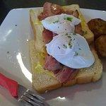 Poached eggs with bacon & potato pieces