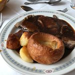Roast beef with vegetables served separately