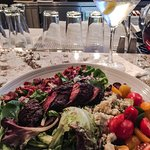 Delicious steak salad and martini!