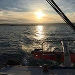 Sun setting while sailing with FunCat Sailing 12-12-2016