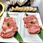 premium rib eye steak and miso shrimp garlic ready to be grilled