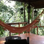 The outside room has relaxing chairs and table, and, a wonderful hammock