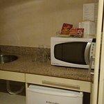 Esta parte é uma mini cozinha dentro do quarto.