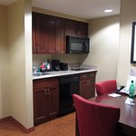 Kitchenette; the refrigerator was behind the wall.
