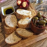 Appetisers - Artisan breads, marinated harlequin olives and mini red peppers stuffed with feta