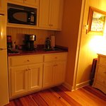 The kitchenette with refrigerator, microwave and coffee maker.
