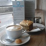 A Flat white, a slab of cake & a view of the sea :)