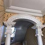 """Archway and molding in the hallway of the """"first floor"""" of Davenport House."""